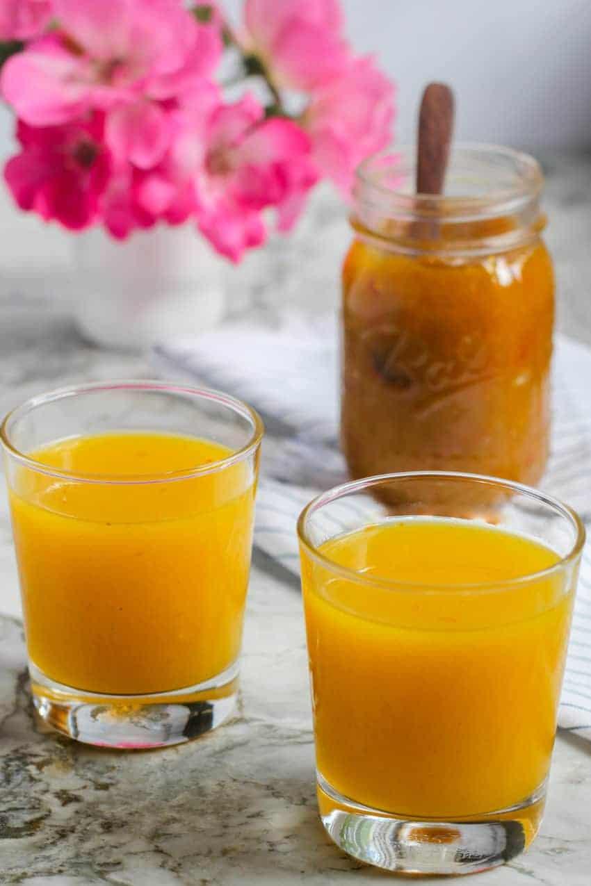two glasses of mango panha and jar of mango jam