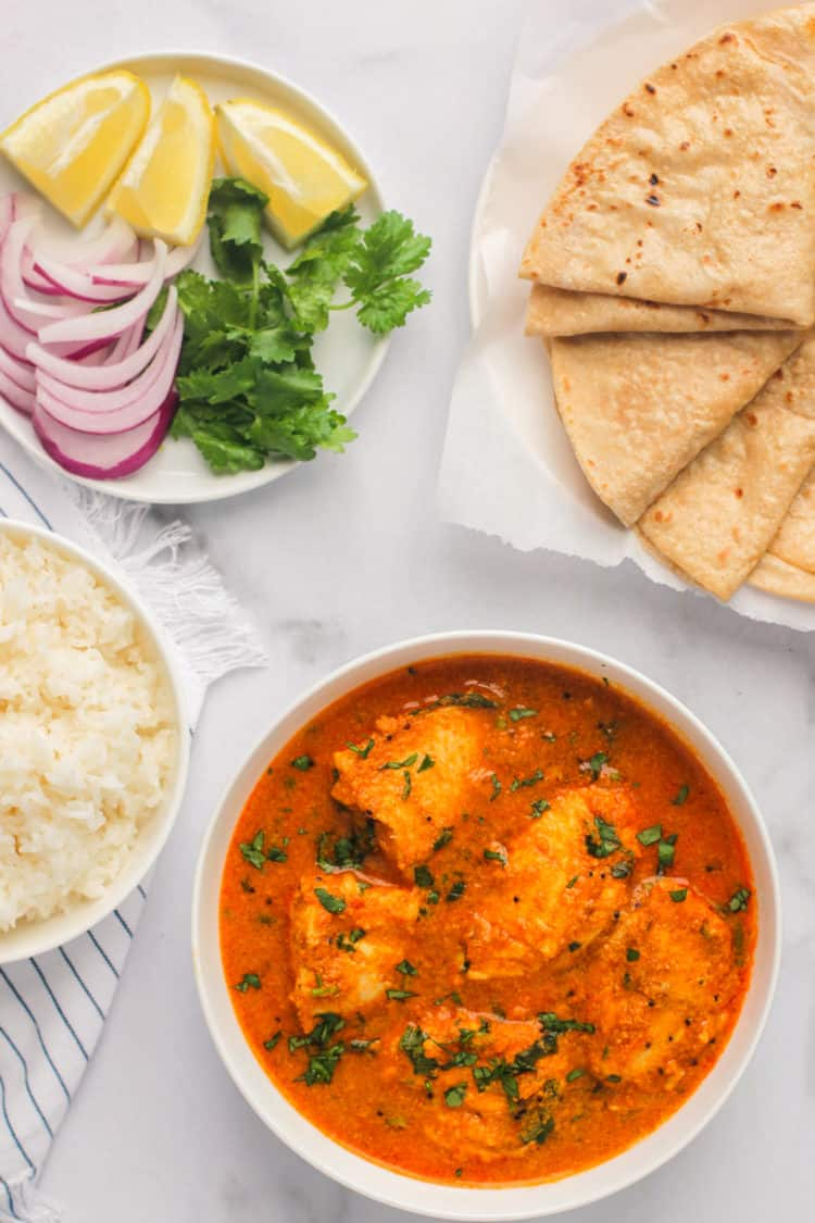 Fish Curry served with rice and rotis