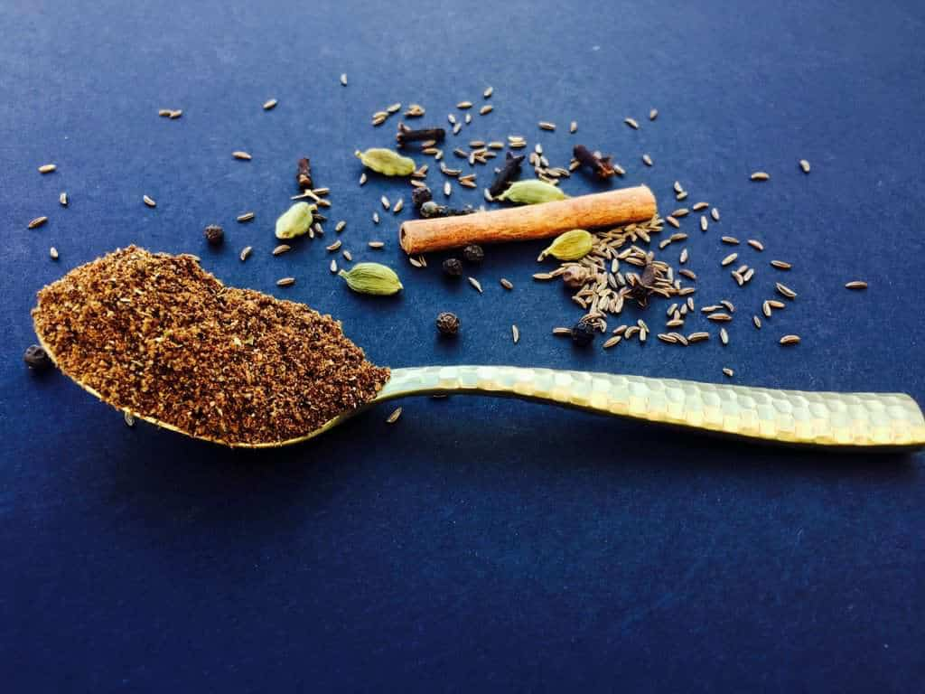 Garam Masala in a gold spoon
