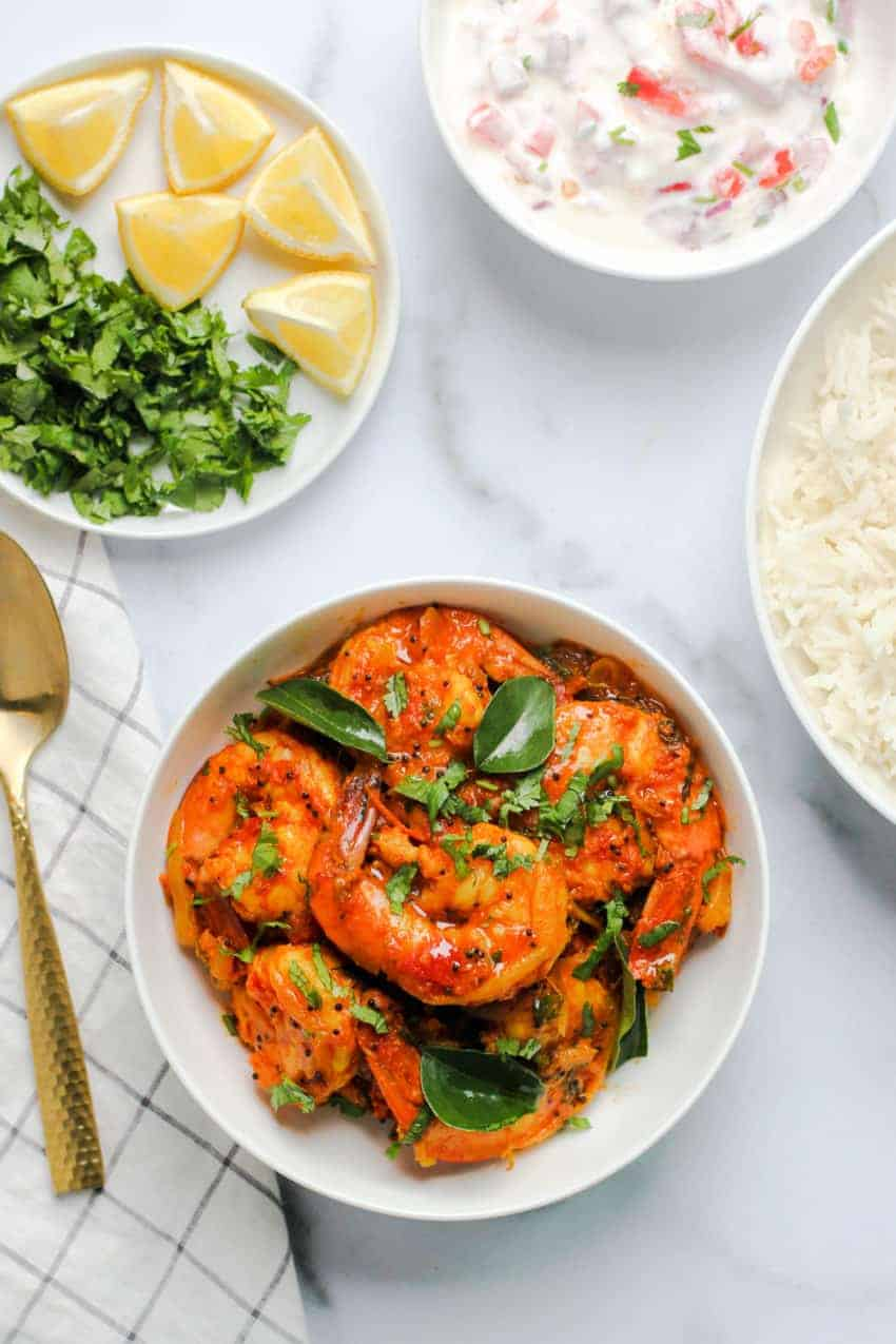 Malabar Shrimp Curry Served with, rice, raita and lemon wedges