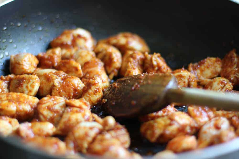 Sautéing chicken with curry paste
