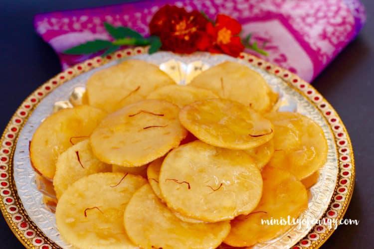 Paakatali puri {fried flatbread glazed in lemon-saffron flavored syrup}