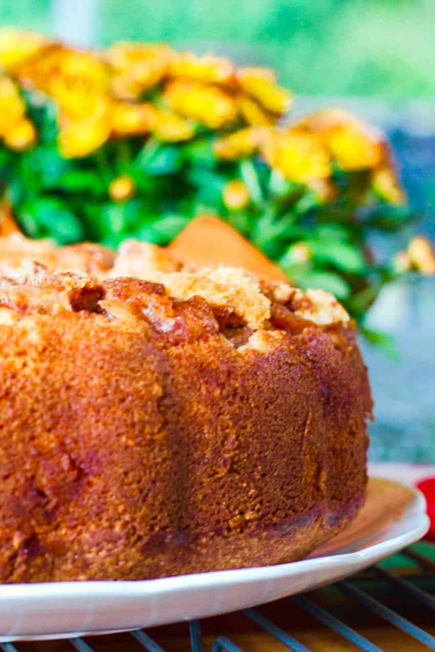 apple cake with orange mums in the background