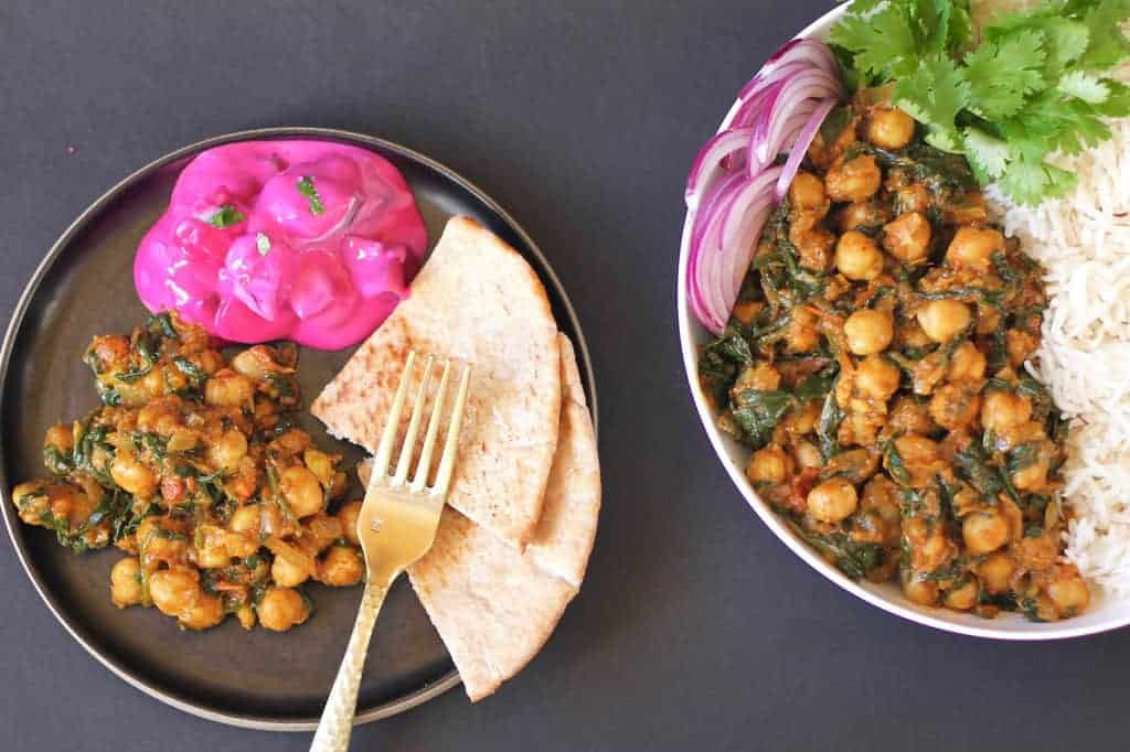 chana saag served with pita bread and raita