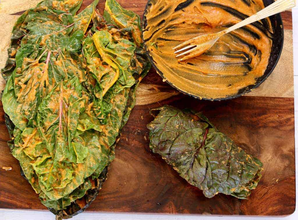 Swiss Chard leaves layered with chickpea flour paste and rolled for Aloo Wadi