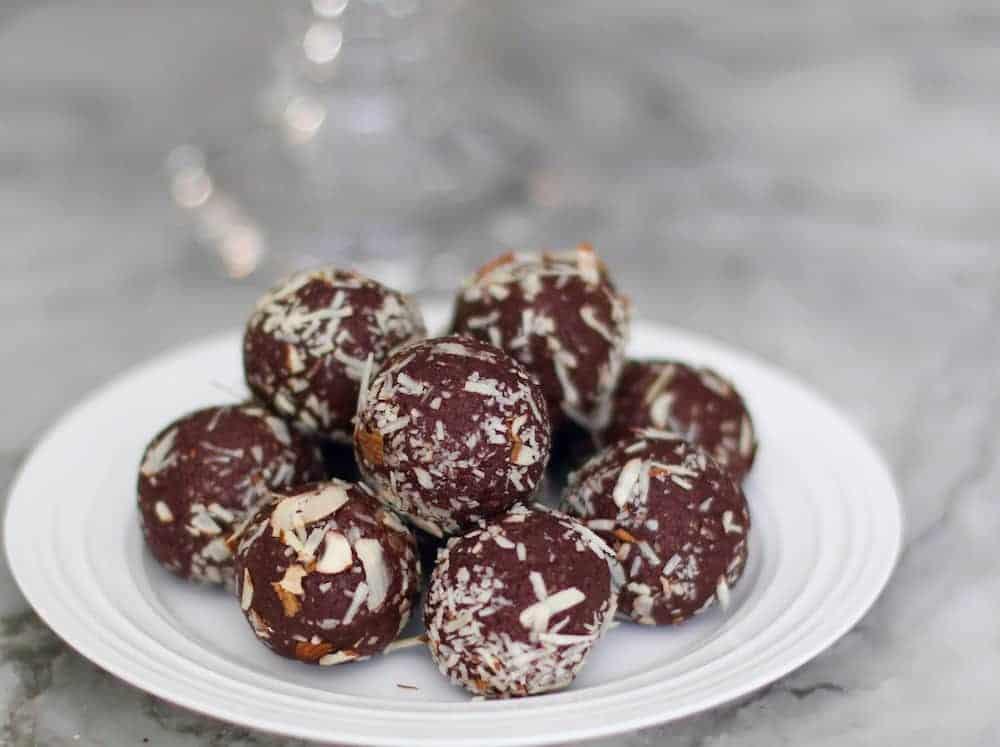 quinoa almond date truffles in a white plate.