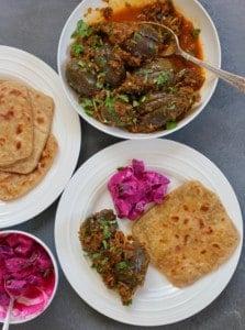 baingan masala with parathas and raita