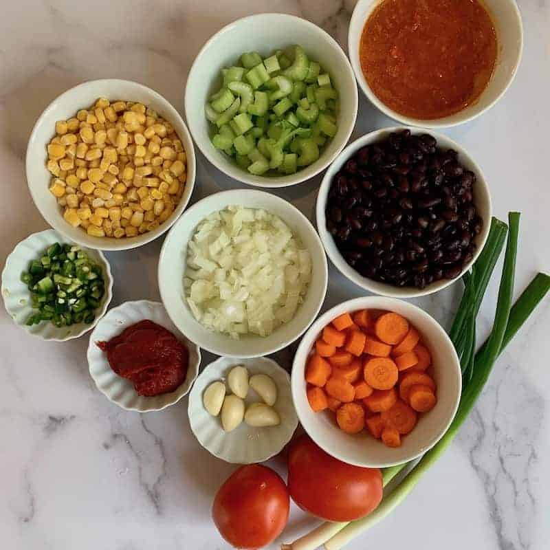 Ingredients for Beffalo Chicken Chili in bowls
