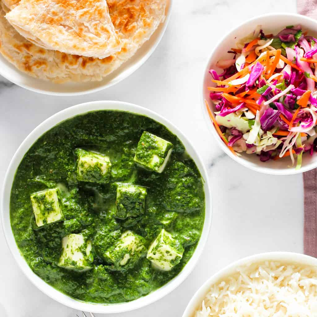 Palak Paneer served with paratha, rice & salad