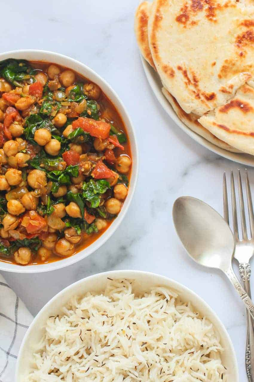 Chana Saag served with naan and rice