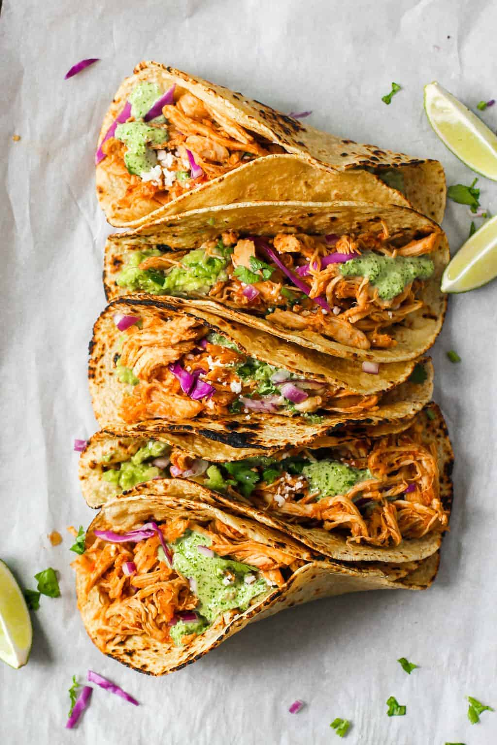 Chicken Tinga Tacos with lemaon wedges on the side