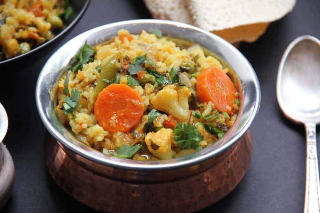 Serving bowl with mixed lentils and vegetable khichdi