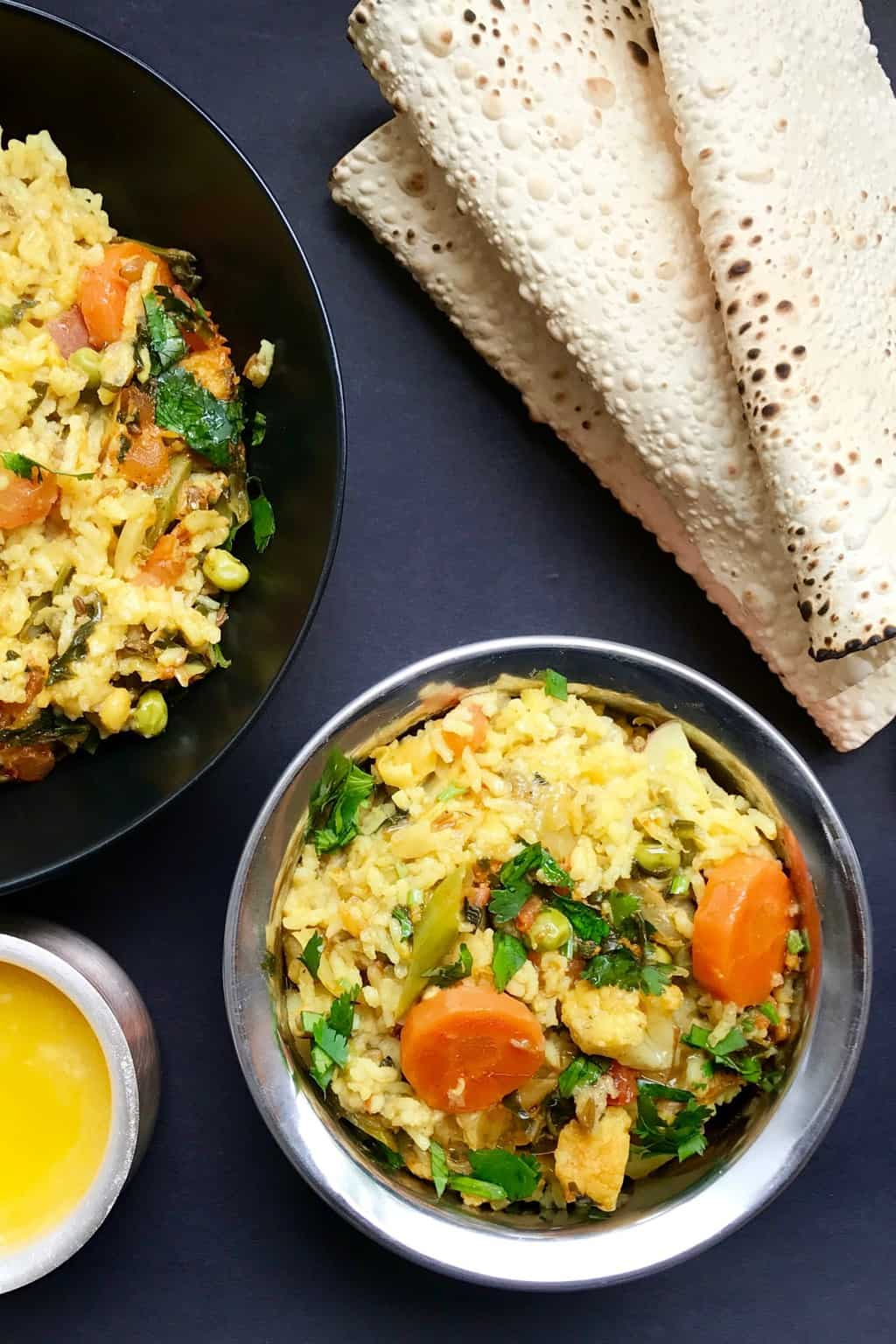 Mixed lentils khichdi served with papad