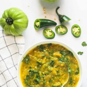 green tomato chutney in a white bowl