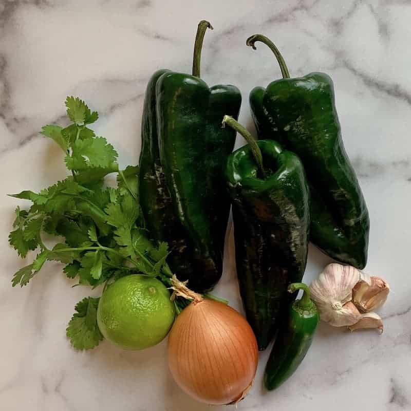 vegetables for chili on marble cutting board