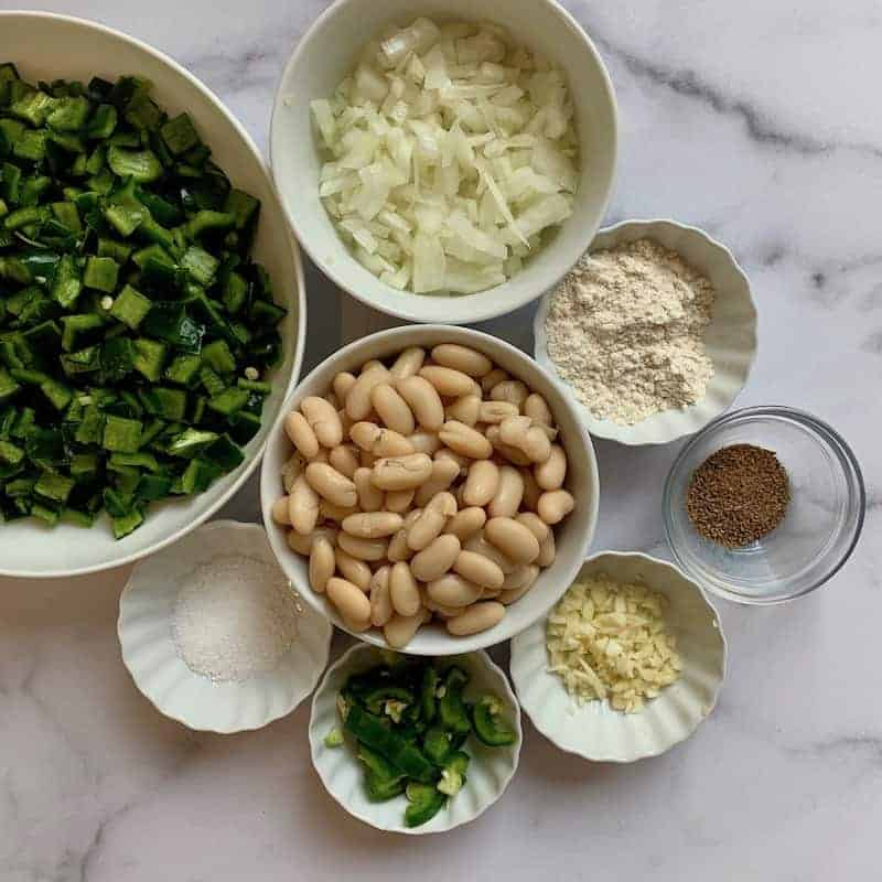 ingredients in white bowls for white chicken poblano chili