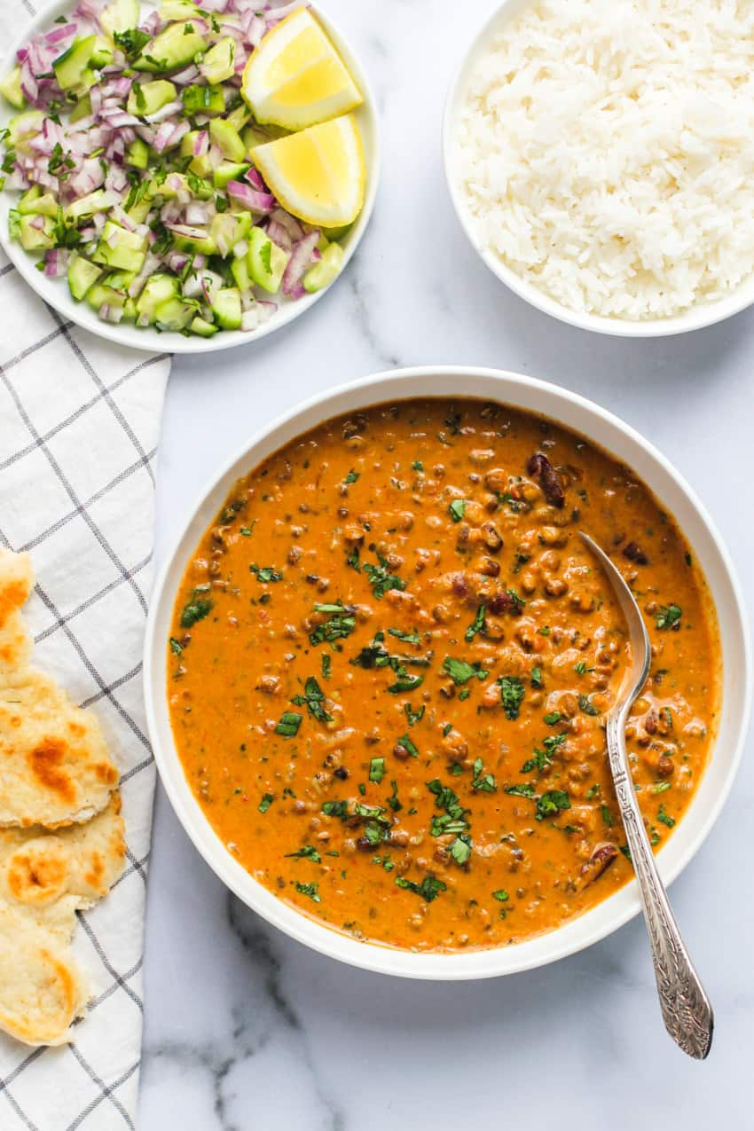 daal makhani served with naan and rice
