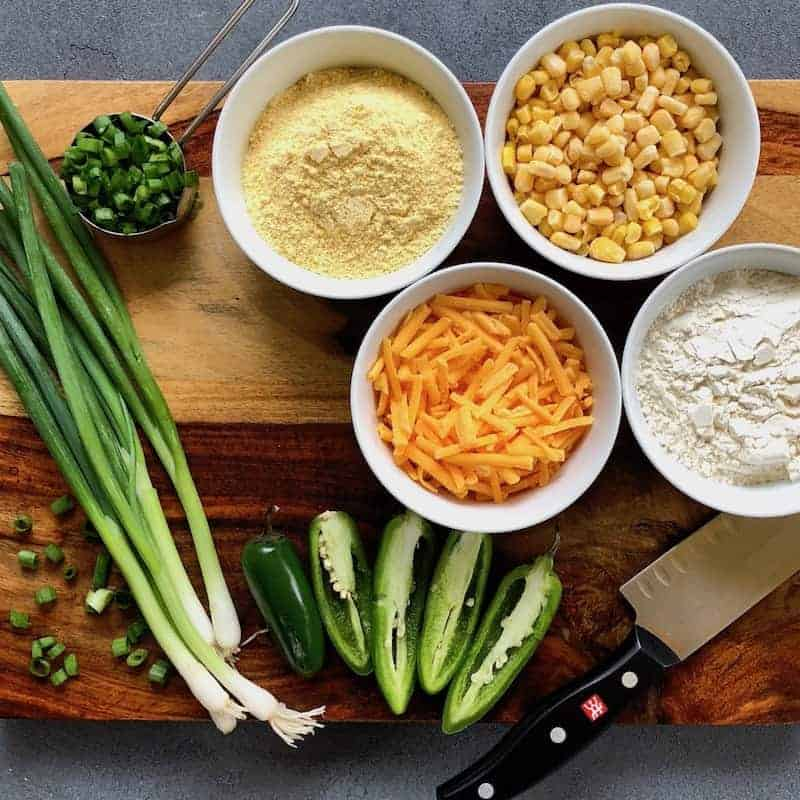 Ingredients for Jalapeno Cheddar Cornbread on a wooden cutting board