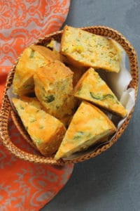 Jalapeno Cheddar Cornbread Sliced in a wicker basket