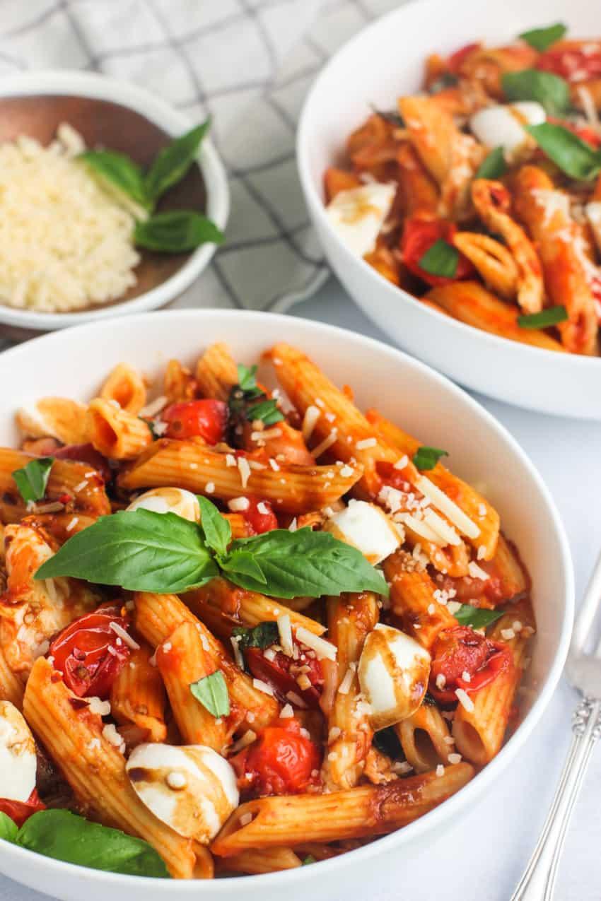 pasta caprese in a white bowl