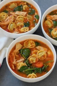 3 white bowls with chicken tortellini soup