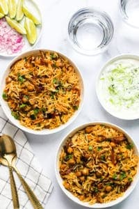 chickpea biryani served with cucumber raita