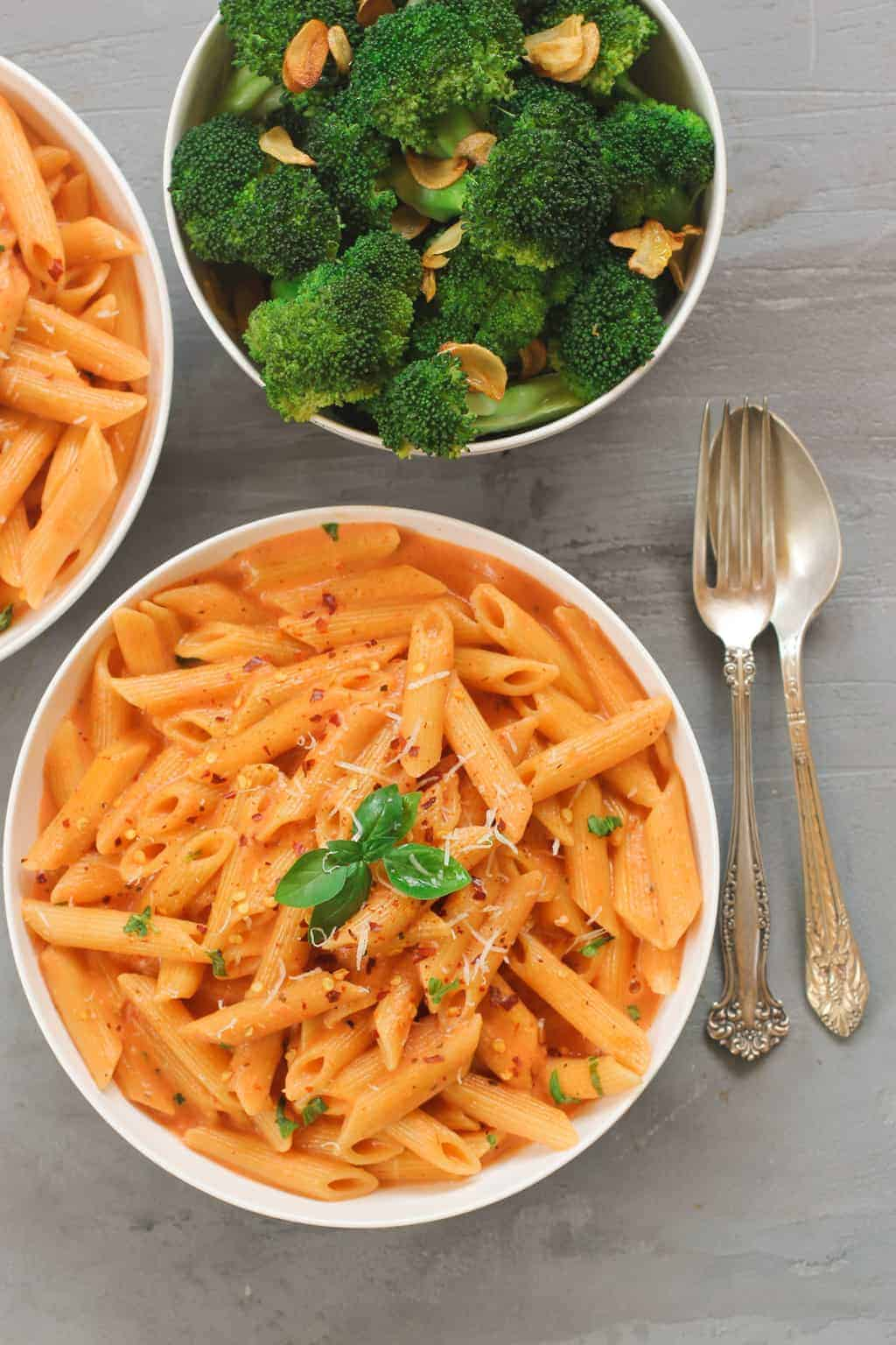 Pasta with Creamy Tomato Sauce served with broccoli