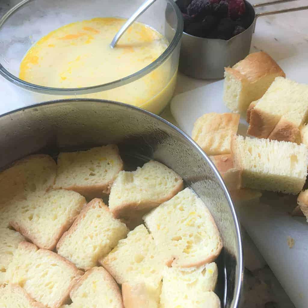 layering bread in a steel pan
