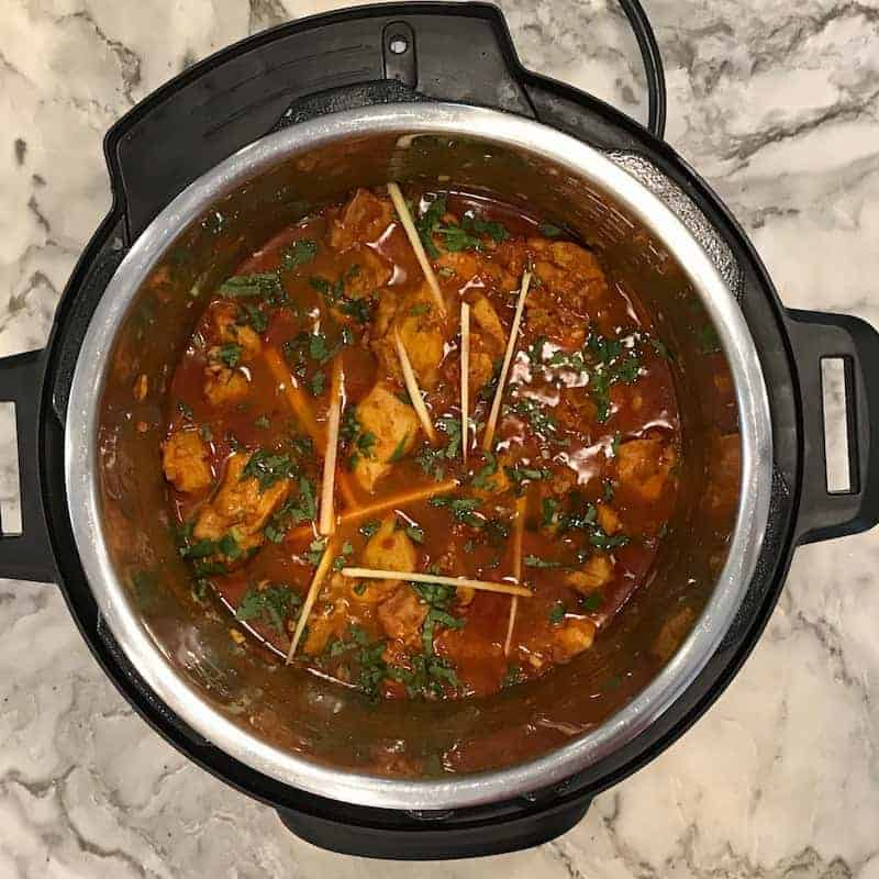 Chicken Karahi in the Instant pot garnished with cilantro and ginger