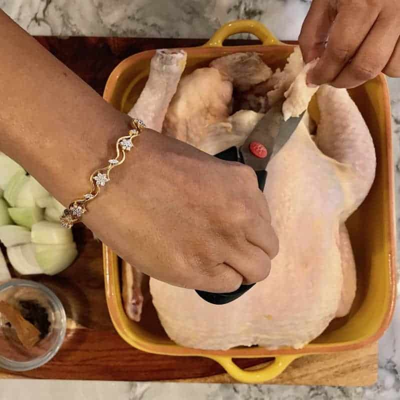 Trim the excess fat from the chicken with sheers