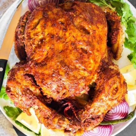 Whole Tandoori Chicken in a platter