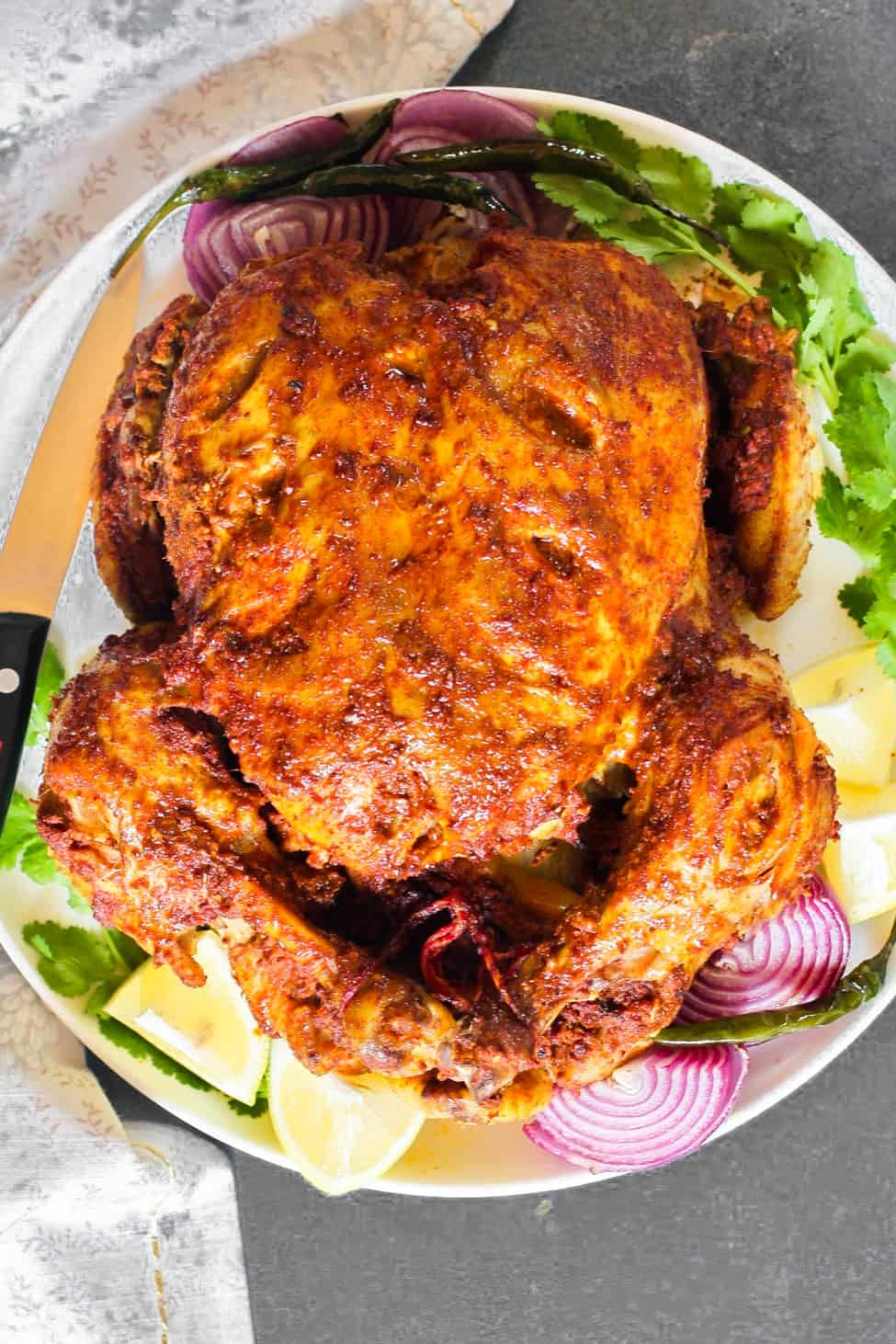 Whole Tandoori Chicken in a platter