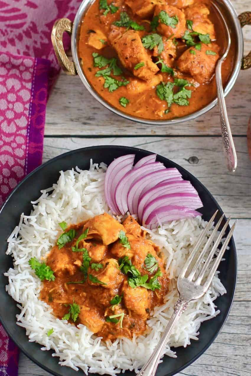 butter chicken served over rice