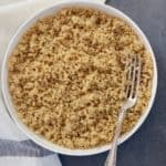 Quinoa in a white bowl with fork