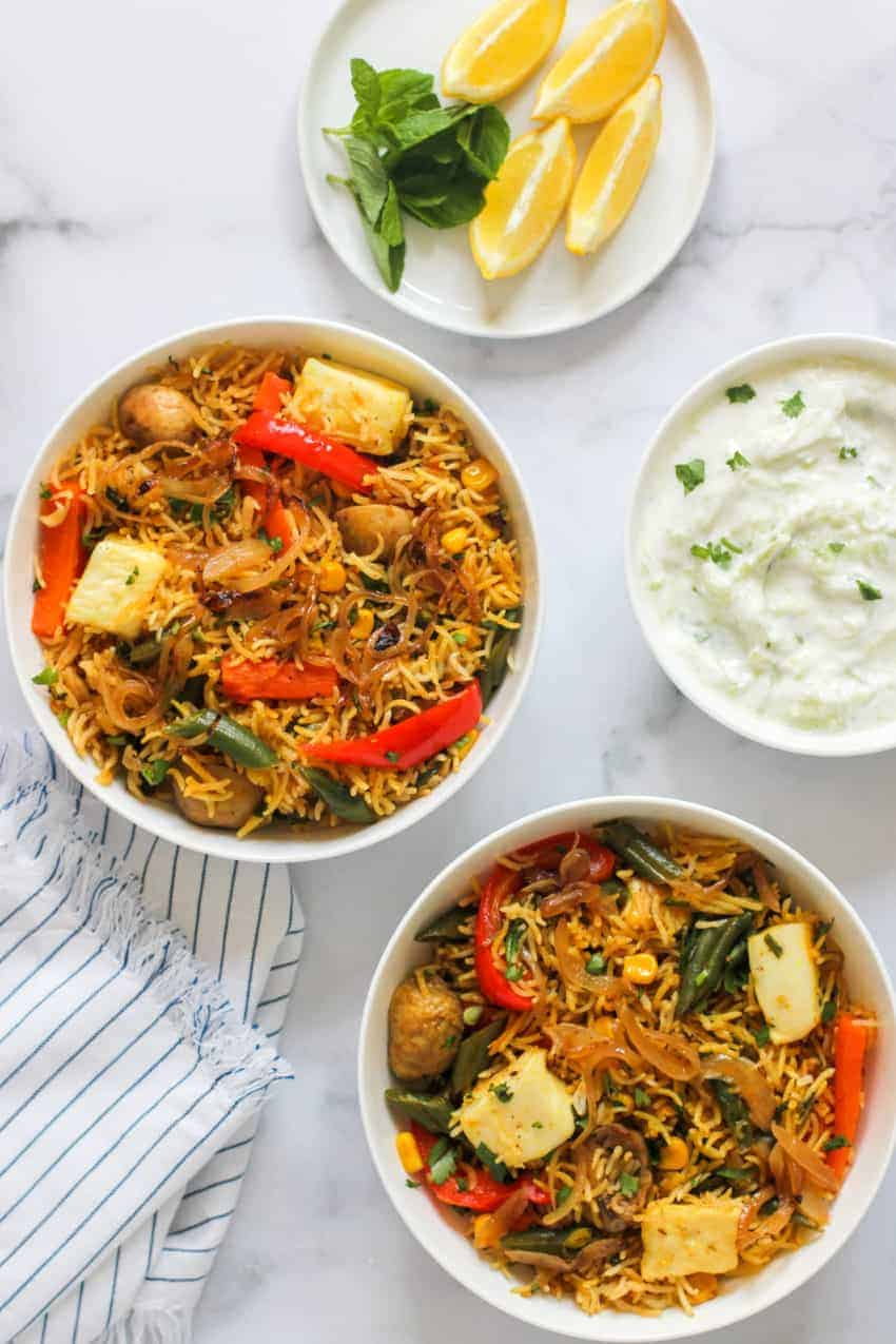 paneer & vegetable biryani with raita and lemon wedges
