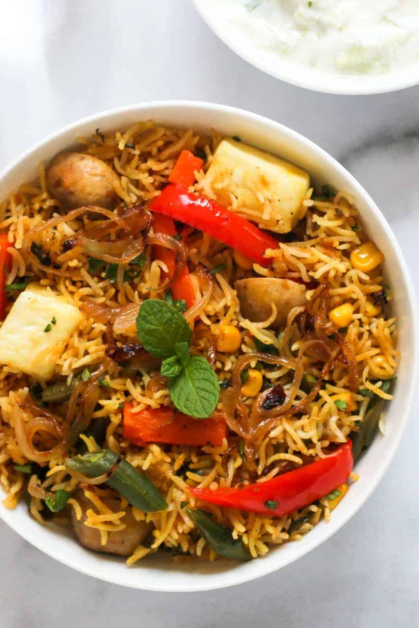 paneer & vegetable biryani in white bowl