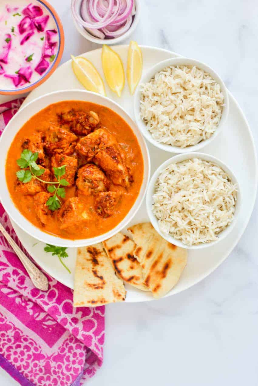 Large platter with chicken tikka masala, rice and naan