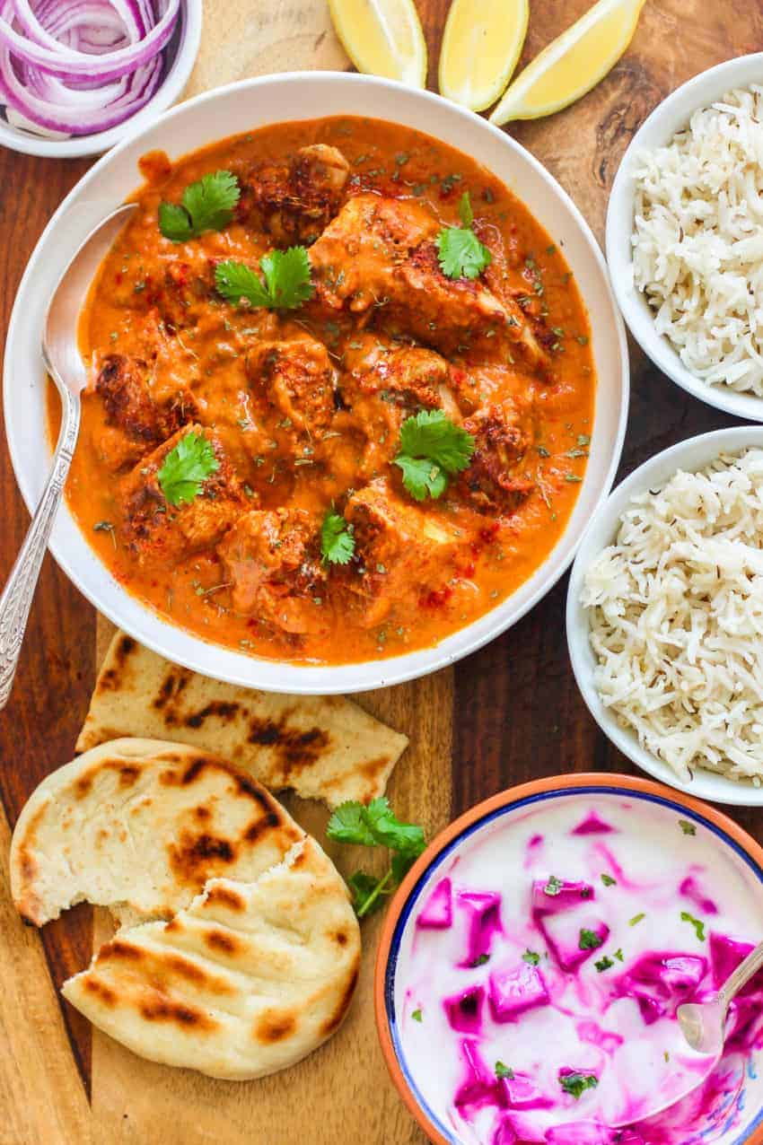 Chicken Tikka masala served with rice, naan and raita