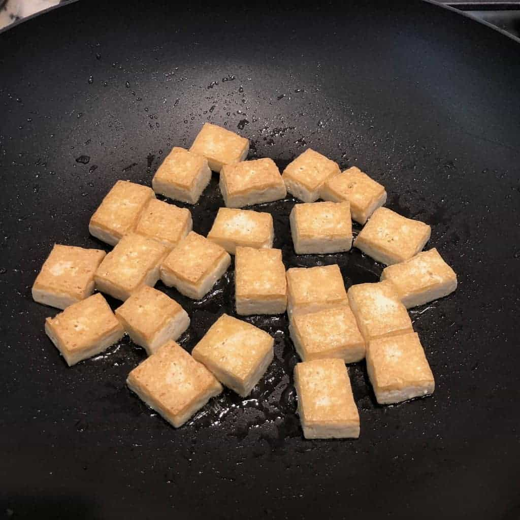 stir fried tofu in a pan