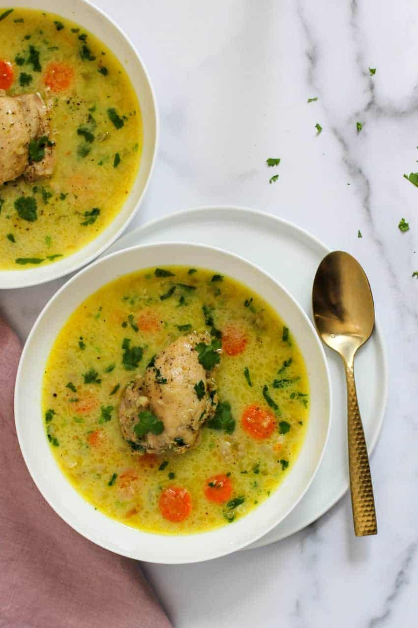 photo of chicken mulligatawny soup served in 2 white bowls