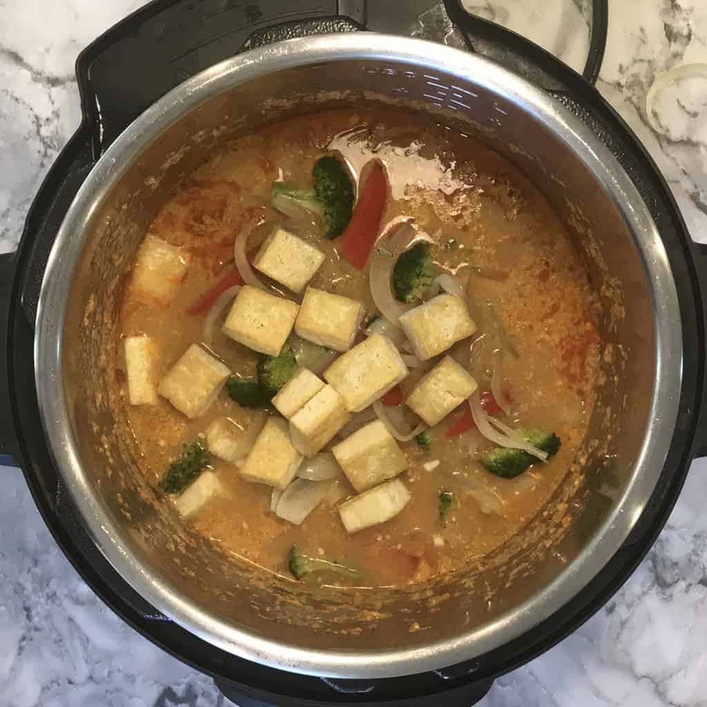 Instant Pot with added sauteed veggies and tofu to the cooked noodles
