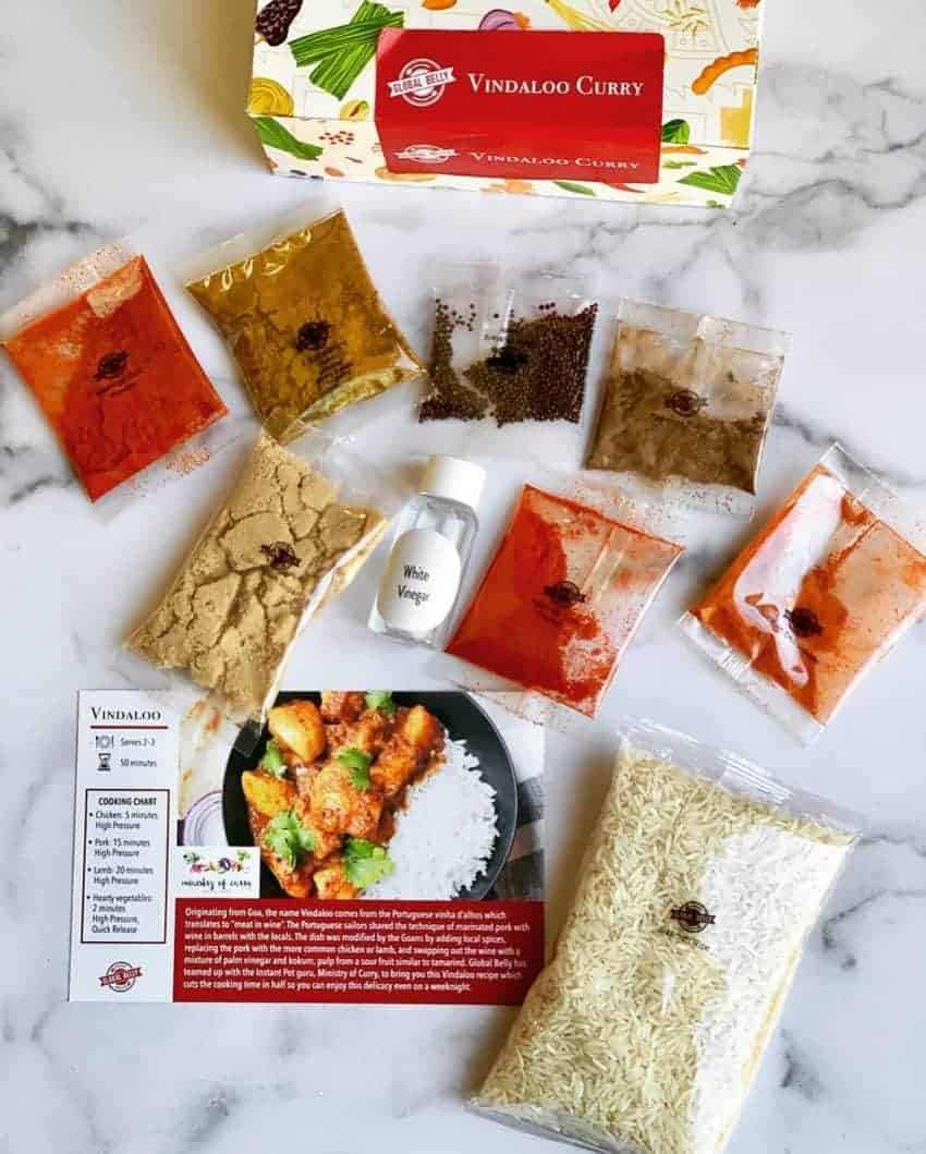 Vindaloo curry pantry kit with all the spices and ingredients laid in front