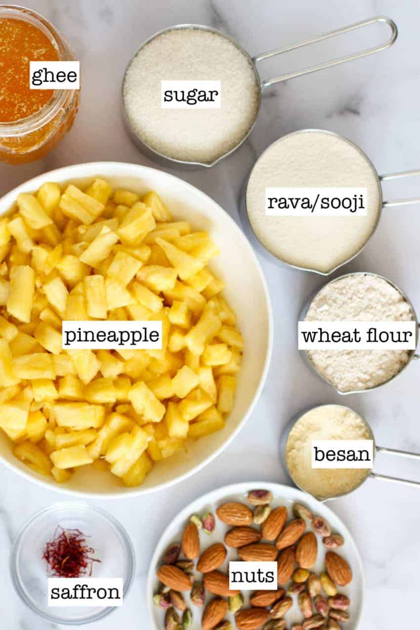 cut pineapples in a bowl with all the other ingredients in measuring cups