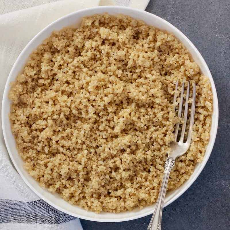 Bowl of cooked quinoa with a fork