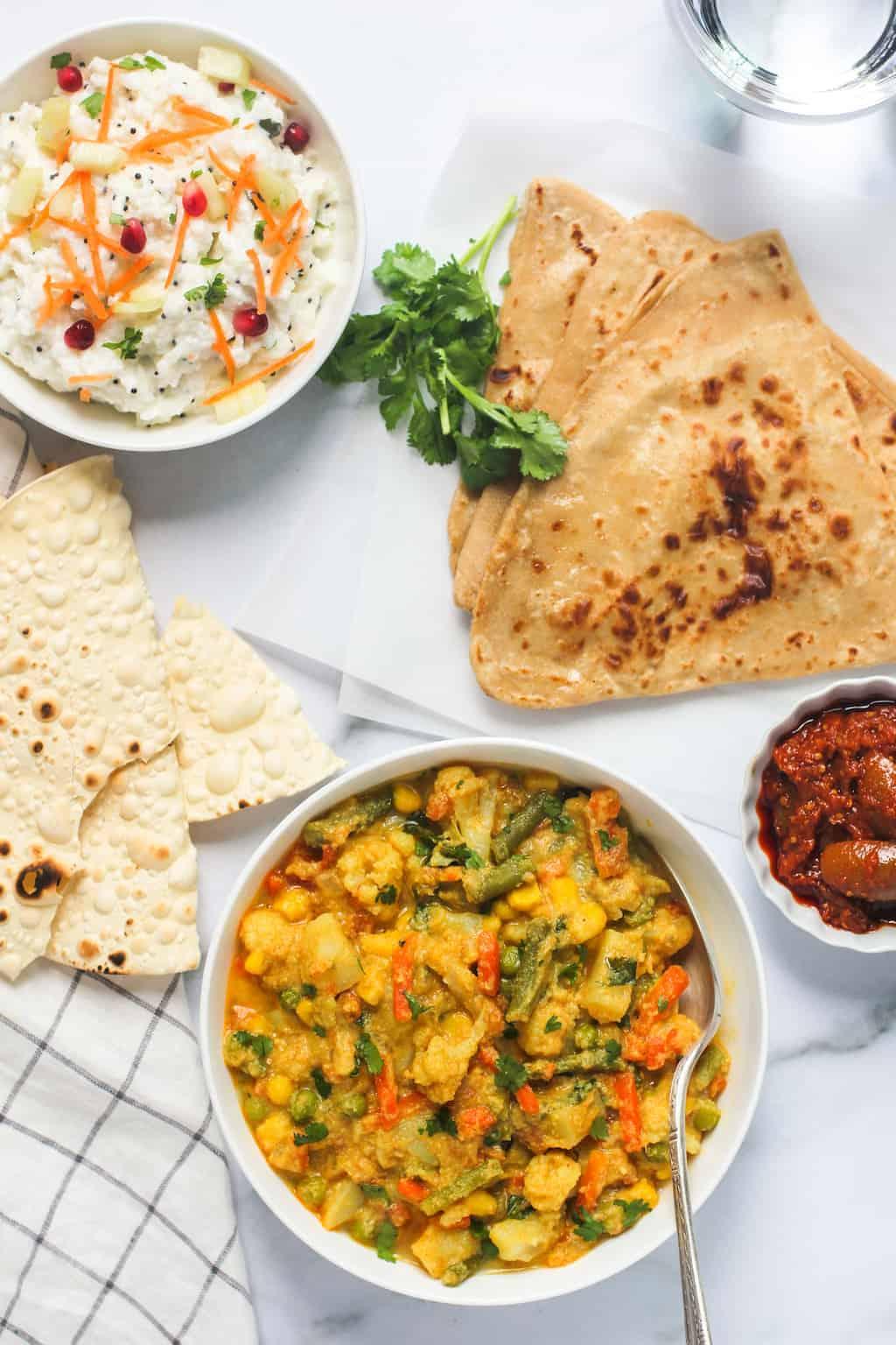 Veg Kurma served with parathas, rice and papad