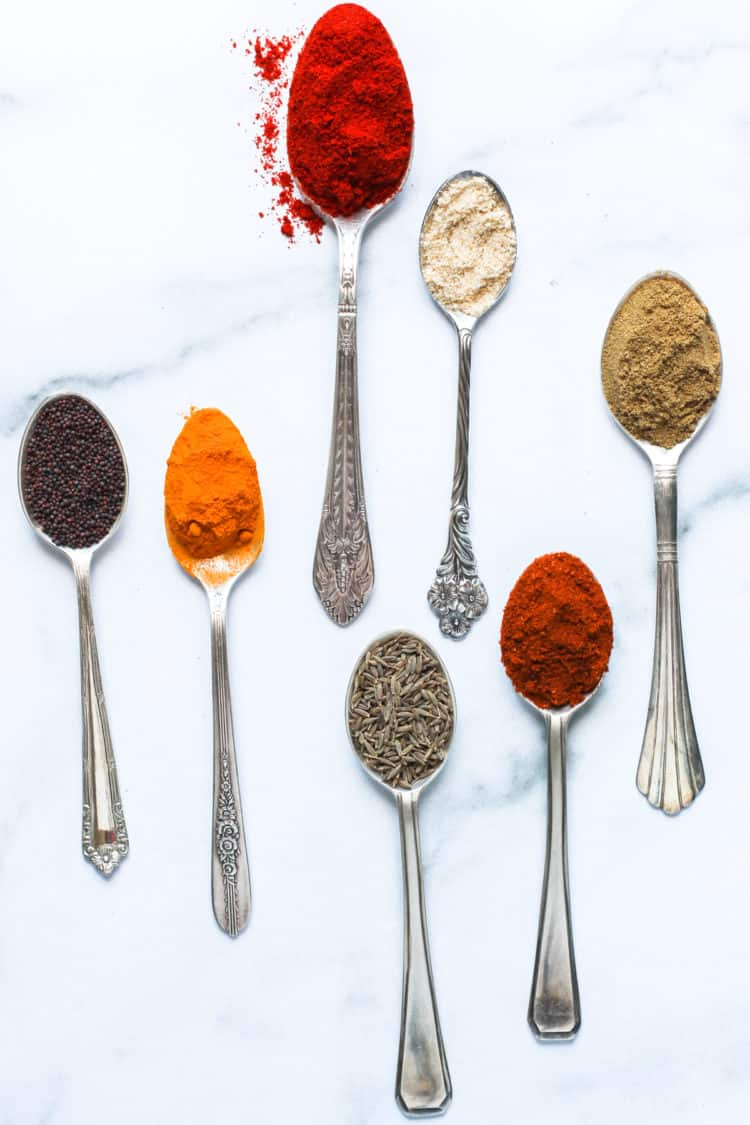 spices displayed in spoons