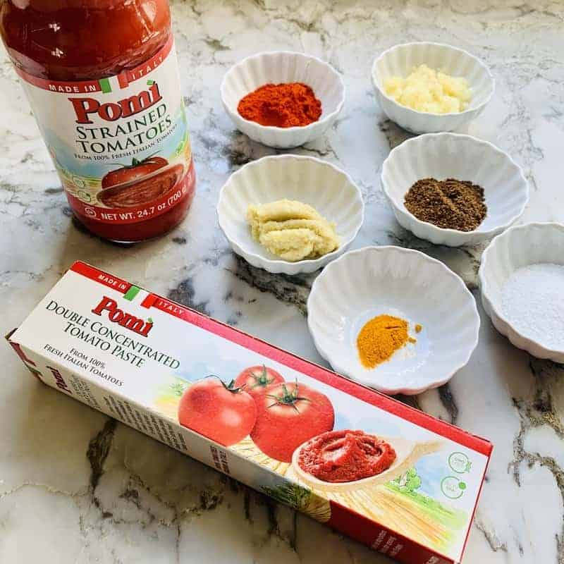 Ingredients for chicken tikka masala - tomato puree, tomato paste and spices.
