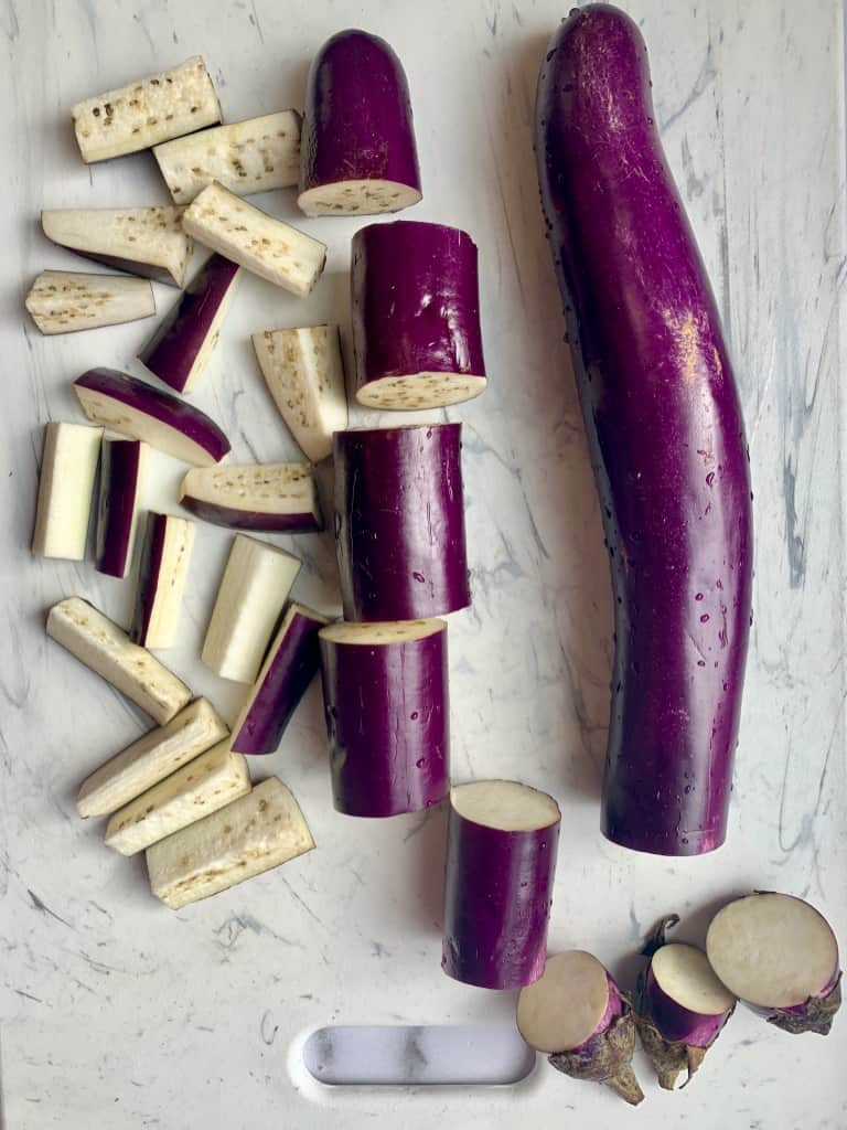 chinese eggplant cut on a cutting board