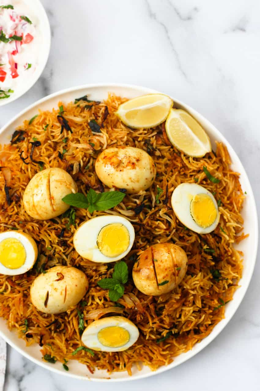 Egg Biryani served in a large white platter