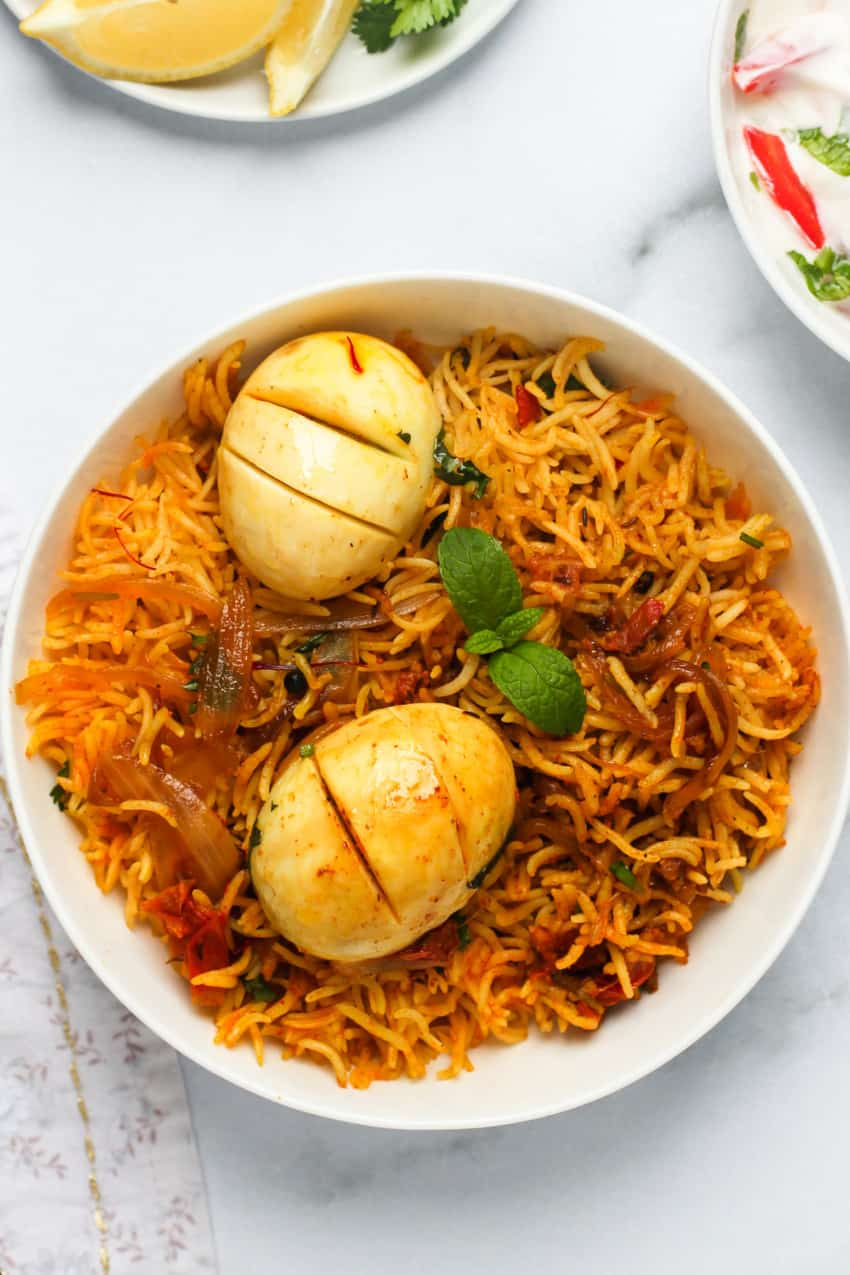 Egg Biryani served in a white bowl